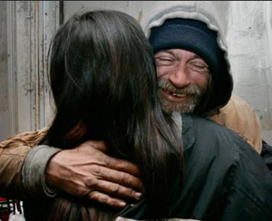 homeless man being hugged on a holiday