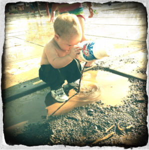 Toddler in the Mud